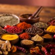 Wooden table of colorful spices — Stock Photo #55762939