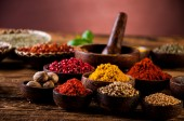 Hot spices in wooden bowls — Stock Photo