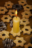 Candle and cookies. — Stock Photo