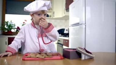 Boy putting cookies — Stock Video