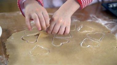 Removing dough around cookies — Stock Video