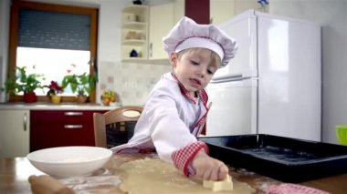 Cook in kitchen stamping cookies — Stock Video