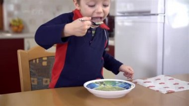 Youngster eating soup — Stock Video