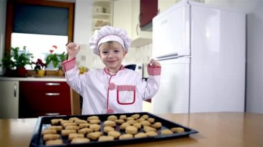 Young baker celebrating — Stock Video