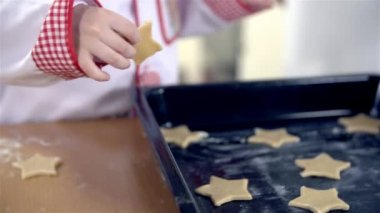 Baker  putting cookies on tray — Stock Video