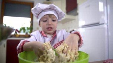 Boy kneading dough — Vídeo de stock