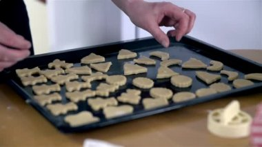 Woman putting cookies on  Tray — Stock Video