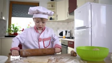 Boy rolling dough — Stock Video
