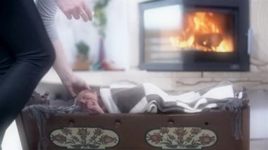 Crib With Baby and Fireplace — Vídeo de stock