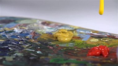 Yellow color paint falling — Stockvideo