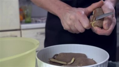 Man peeling Potato — Stock Video