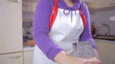 Cook Scrubbing Cheese on Pizza — Stock Video