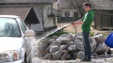 Man Spraying car with Water — Stockvideo