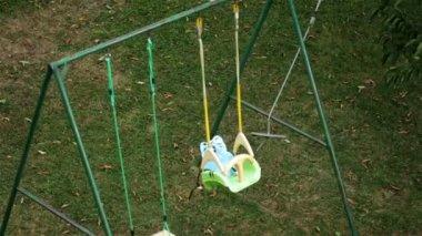 Kids' swing blown away — Stock Video