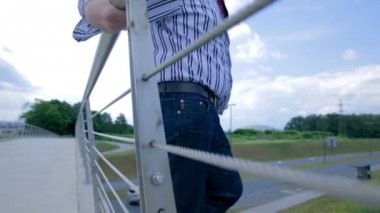 Businessman standing On The Edge of Bridge — Stock Video