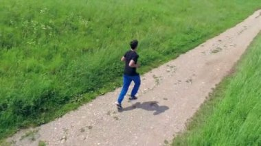 Person running on a trail — Stockvideo