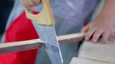 Boy Sawing Small Stick — 图库视频影像