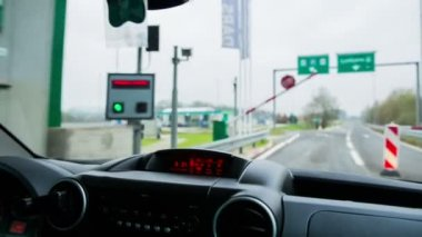 Driving through toll station — Stock Video
