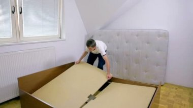 Person removing big wooden desks — Stock Video