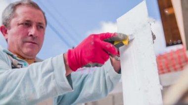 Man cutting Styrofoam — Stock Video