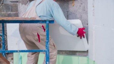Person putting Styrofoam block — Stock Video