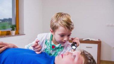 Doctor checking eyesight — Stock Video