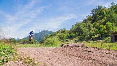 Motorcross rider landing — Stockvideo