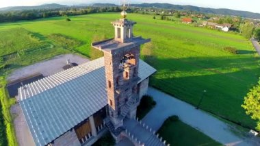 Old church monument with green lawn — Stock Video