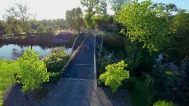 River with pedestrian iron bridge. — Stock Video