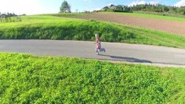 Boy running on countryside road — Vídeo stock