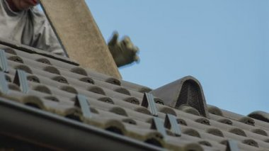 Man Adding  Roof Tile — Stock Video