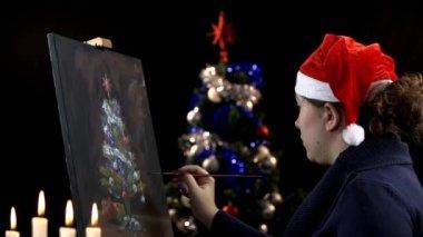 Artist painting Christmas tree — Stock Video