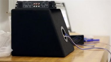 Amplifier and car subwoofer — Stock video
