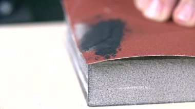 Blowing graphite from sanding paper — Stock Video