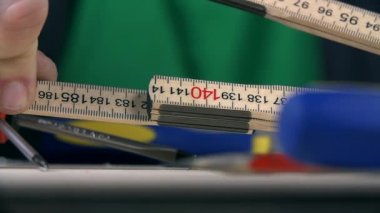 Folding together woodworking ruler — Stock Video