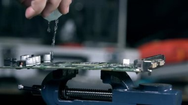 Pouring graphic card with liquid — Vídeo de Stock