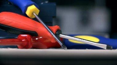 Many screwdrivers on workshop desk — Стоковое видео