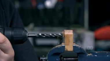Drilling a wood plank — Stock Video