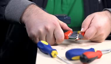 Man sharpening new pencil — Стоковое видео