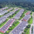 Aerial view of large apartment complex by the river — Stock Video #68356247