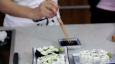 Woman Mixing Wasabi in Soy sauce — Stock Video