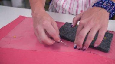 Woman Pinning plastic foil — Stock Video