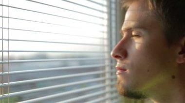 Man Watching outside — Стоковое видео