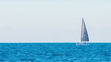 Sailboat traveling on wavy sea — Stock Video