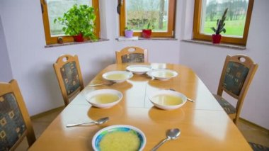 Kitchen table with soup — Stock Video
