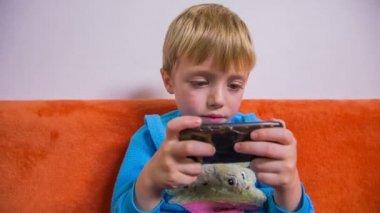 Kid  looking on smartphone. — Stock Video