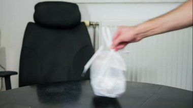 Man Leaving  plastic bag — Stock Video