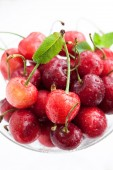 Fresh wet cherry in a glass, — Stock Photo