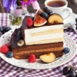 Piece of chocolate cake with cream and fresh fruit — Stock Photo #56574659