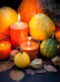 Pumpkins and candles — Stock Photo